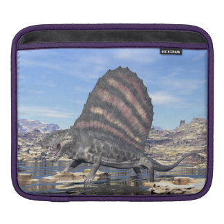 Dimetrodon standing in a pond in the desert iPad sleeves
