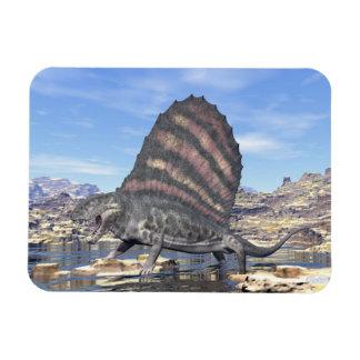 Dimetrodon standing in a pond in the desert magnet