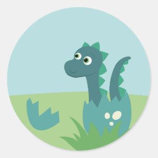 Dinosaur baby in egg sticker. classic round sticker