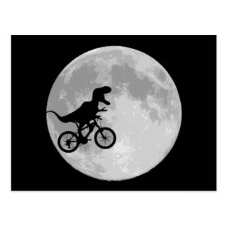Dinosaur on a Bike In Sky With Moon Postcard