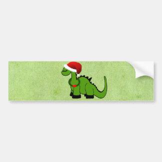 Dinosaure vert dans un chapeau de Père Noël pour N Autocollant De Voiture