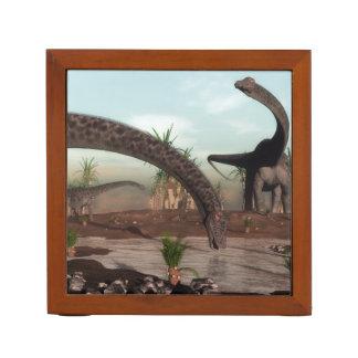 Diplodocus dinosaurs herd going to drink desk organizer