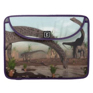 Diplodocus dinosaurs herd going to drink sleeve for MacBook pro
