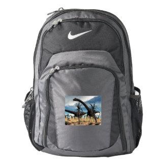 Diplodocus dinosaurs herd in the desert backpack