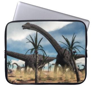 Diplodocus dinosaurs herd in the desert laptop sleeve
