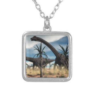 Diplodocus dinosaurs herd in the desert silver plated necklace