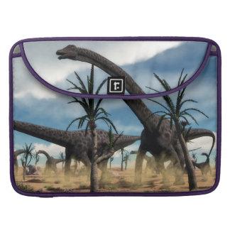 Diplodocus dinosaurs herd in the desert sleeve for MacBooks