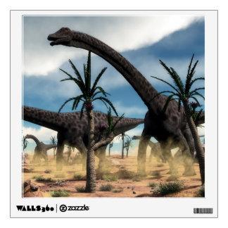 Diplodocus dinosaurs herd in the desert wall sticker