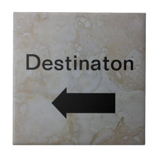 Directional arrow sign black on travertine photo tile