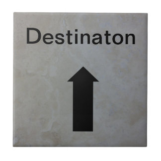 Directional arrow sign black on travertine stone tile