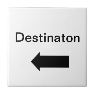 Directional arrow sign black on white tile