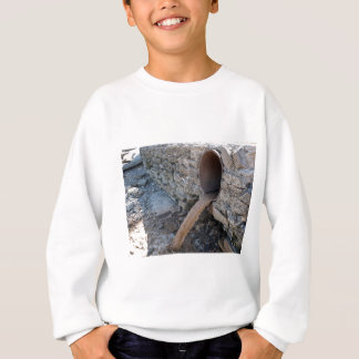 Dirty water flows from a brown rusty pipes sweatshirt