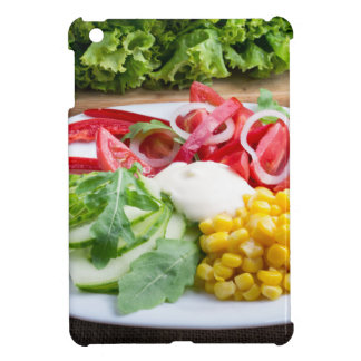 Dish from tomatoes, bell-pepper, mozzarella cheese case for the iPad mini