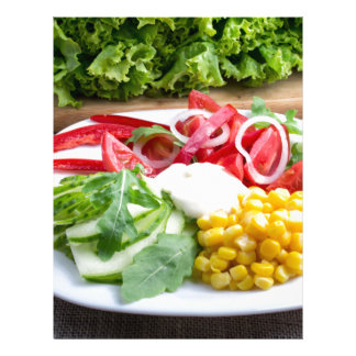 Dish from tomatoes, bell-pepper, mozzarella cheese letterhead