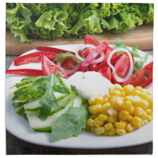 Dish from tomatoes, bell-pepper, mozzarella cheese napkin