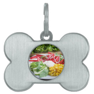 Dish from tomatoes, bell-pepper, mozzarella cheese pet ID tag