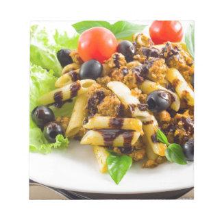 Dish of Italian pasta rigatoni with bolognese Notepad