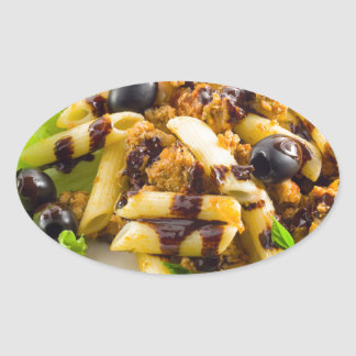Dish of Italian pasta rigatoni with bolognese Oval Sticker
