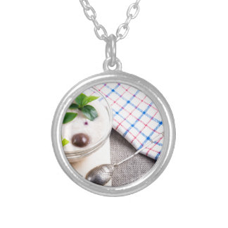 Dish of oatmeal in a bowl of glass silver plated necklace