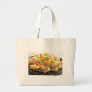 Dish of stewed potatoes with chicken and spices large tote bag