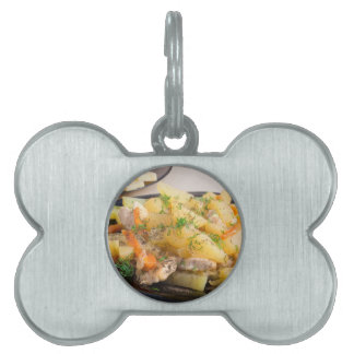 Dish of stewed potatoes with meat and spices pet tag