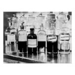 Display of apothecary bottles containing drugs poster