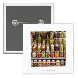 Display of pickled fruits and vegetables. 2 inch square button