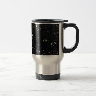 Distant galaxies on a travel mug. travel mug