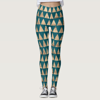 Distressed gold tone triangles on teal green leggings