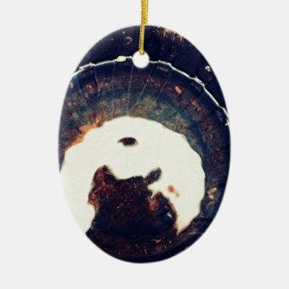 Disturbed waters ceramic oval ornament