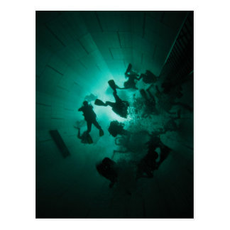Divers in a tunnel postcard
