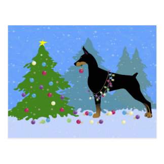 Doberman Decorating Tree in the Forest Postcard