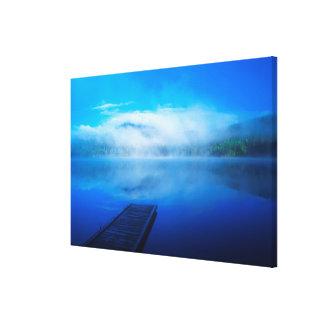 Dock on calm misty lake, California Canvas Print
