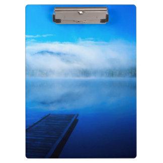 Dock on calm misty lake, California Clipboard