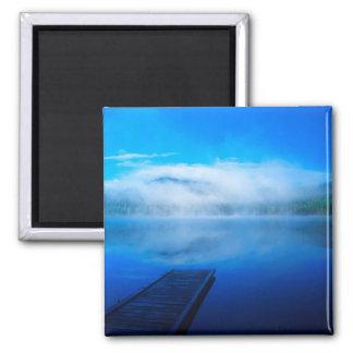 Dock on calm misty lake, California Magnet