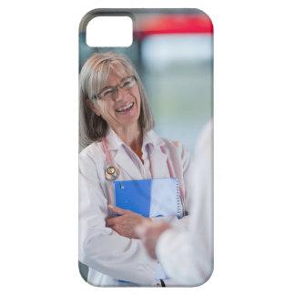 Doctors talking together in hospital hallway iPhone 5 case