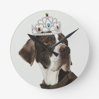 Dog sitting with a tiara on head round clock