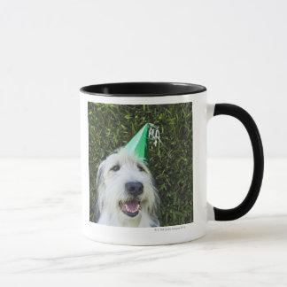 Dog wearing party hat mug