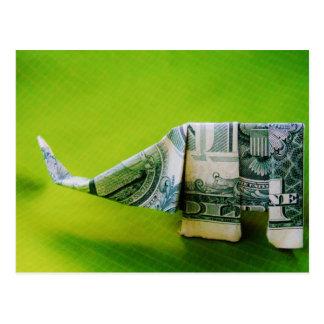 Dollar bill origami Elephant on Green background Postcard