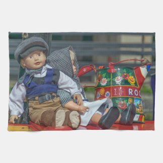 Dolls and watering can kitchen towel