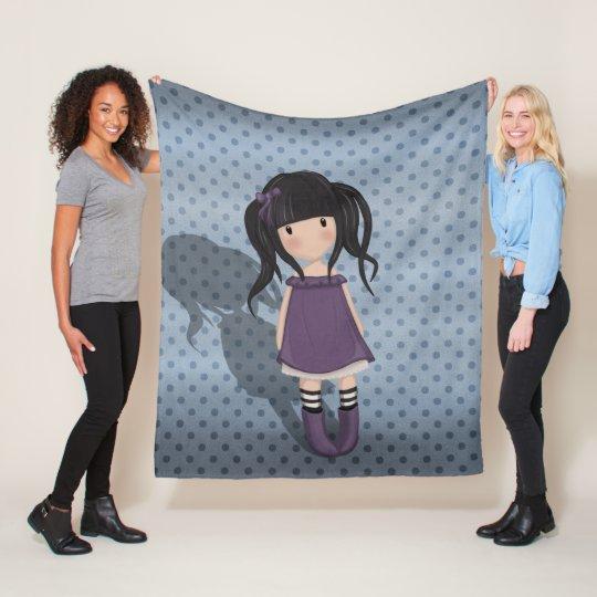 Dolly girl in purple fleece blanket