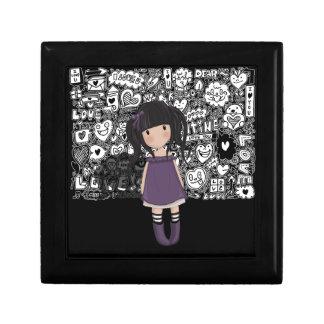 Dolly girl in purple gift box