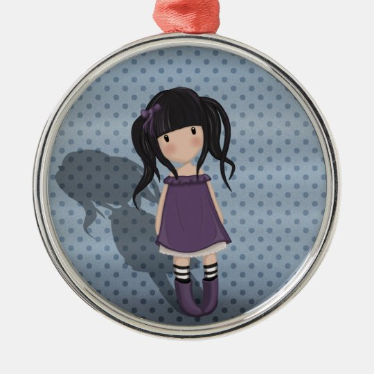 Dolly girl in purple metal ornament