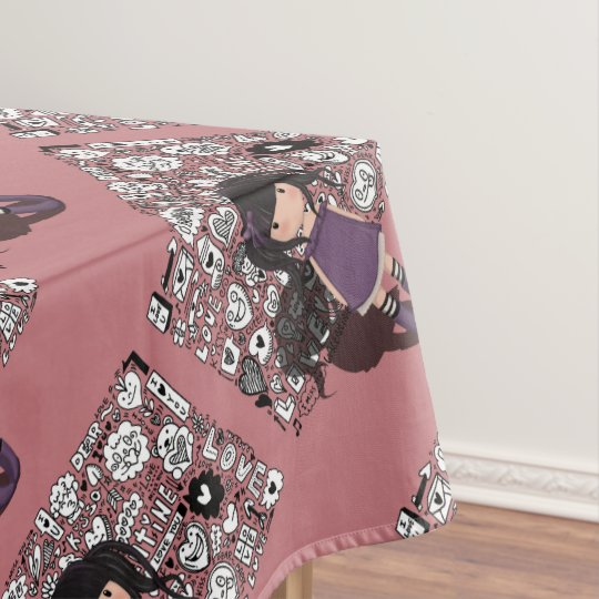 Dolly girl in purple tablecloth
