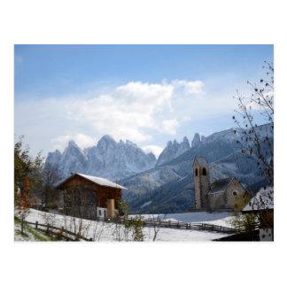 Dolomites church in winter postcard
