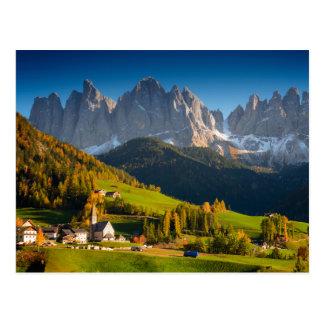 Dolomites village in fall postcard