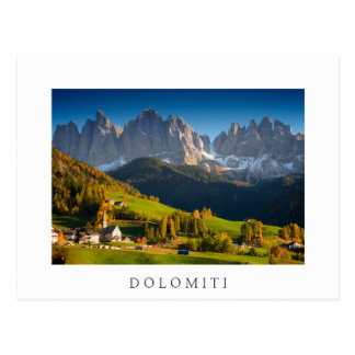 Dolomites village in fall white text postcard
