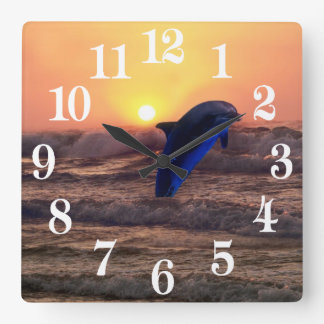 Dolphin at sunset square wall clock