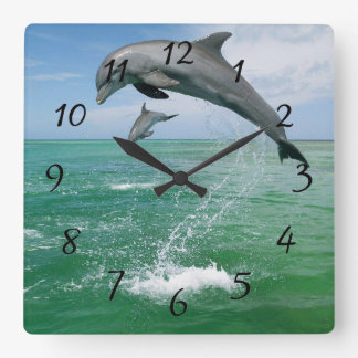 Dolphin in the wild jumping and playing square wall clock