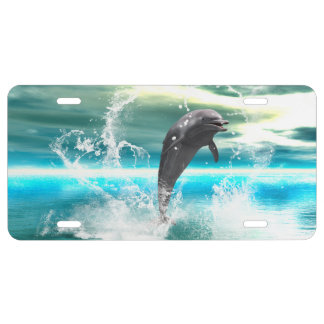 Dolphin jumping in the sea with waves as heart license plate